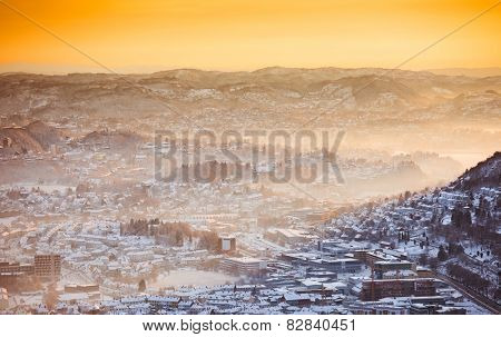 view of winter city with fog  from the mountain top