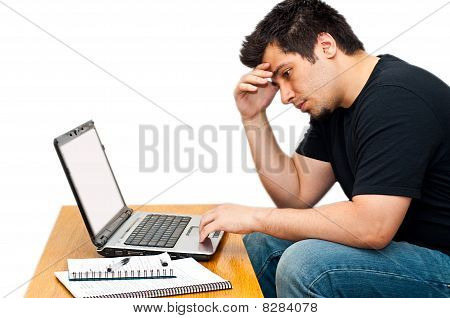Frustrated Guy Using His Laptop