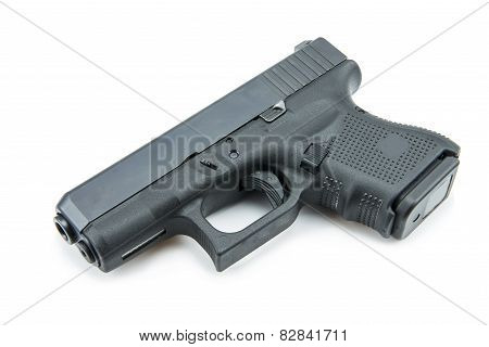 automatic 9mm. handgun pistol on white background.