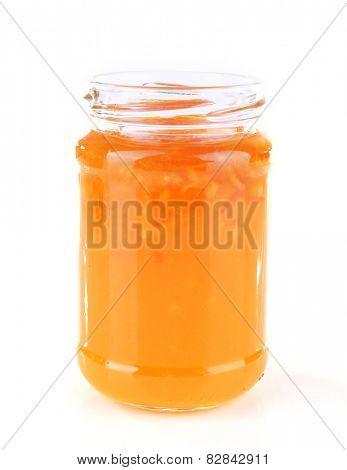 Homemade jar of orange jam isolated on white background