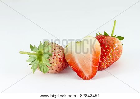 Strawberries Berries with a half section on white