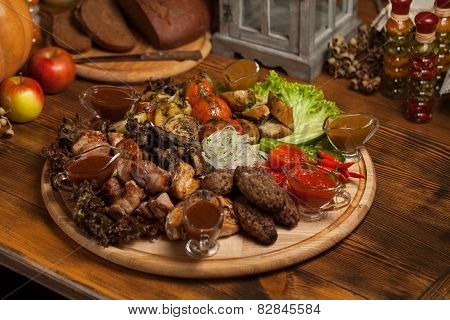 Grilled meat on a wooden tray.