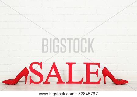 Sale with shoes on floor in room