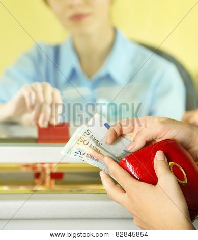 Teller window with working cashier