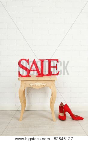 Sale with shoes on side table in room