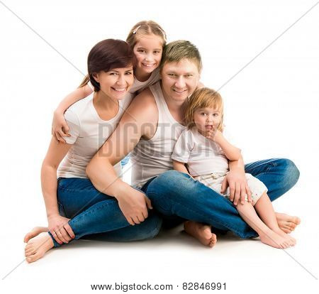 happy four members family isolated on white