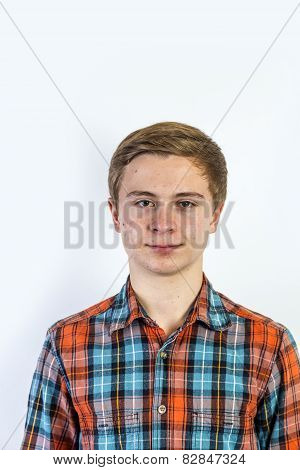 Portrait Of A Positive Boy Looking At Camera