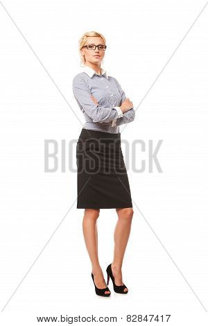 Successful business woman with arms crossed. isolated over white