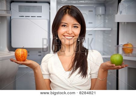 Woman Taking Fruits From The Fridge