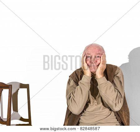 Elderly Man In Sorrow Holding Head In Hands