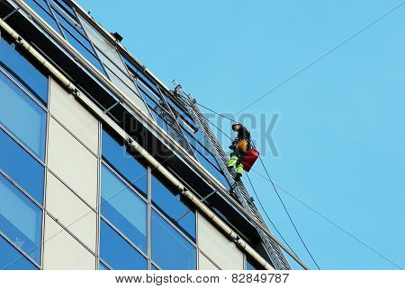 Vilnius City Skyscraper Cleaners At Work On September 24, 2014