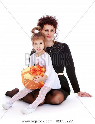 Charming young mother with her beloved daughter.