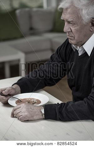 Widower Eating Meal