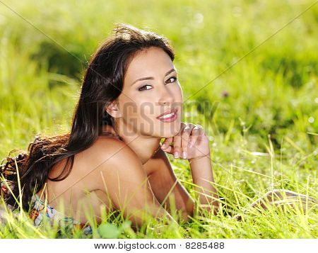 Girl Lying On The Green Grass