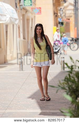 Full Length Shot Of Female Standing At The Street