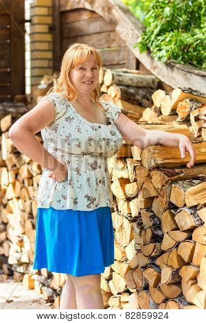 Portrait Of A Women Near Woodpile