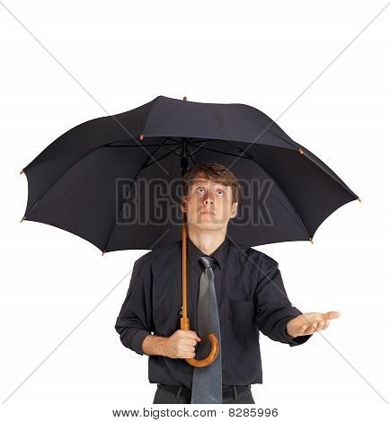 Young Man With Large Black Umbrella