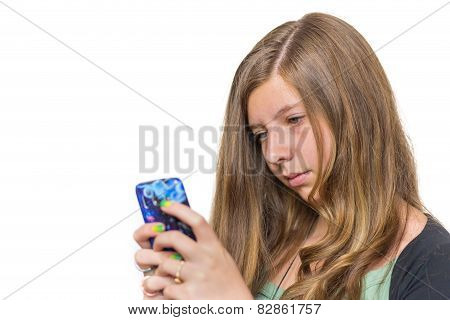 Blonde teenage girl calling with mobile phone