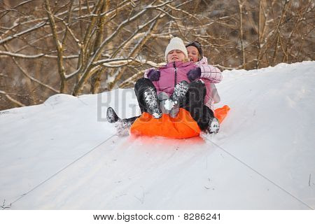 Mother And Daughter Having Fun In Snow