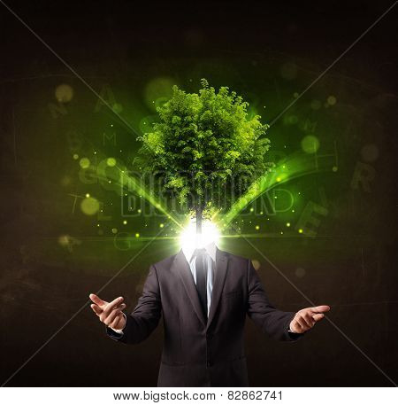 Man with green tree head concept on brown background