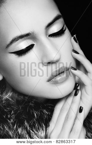 Close-up portrait of young beautiful woman with stylish cat eye make-up