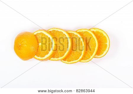 pieces of juicy orange, laid offset isolated on white background