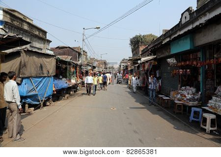 KOLKATA, INDIA - FEBRUARY 10: Tourists and visitors of famous Kalighat Kali Temple have rest near the shrine on Feb 10, 2014 in Kolkata. The name Calcutta to have been derived from the word Kalighat