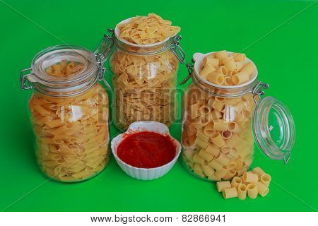 Three Jars Of Pasta With Red Sauce Bowl