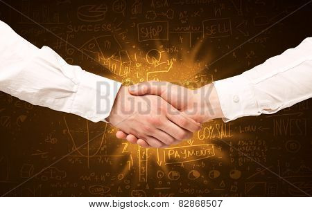 Business hanshake with with glowing background