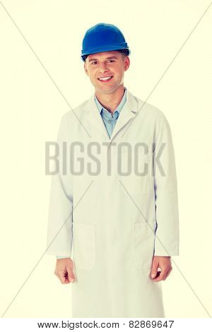 Man in a lab coat and helmet, engineer, teacher or chemical