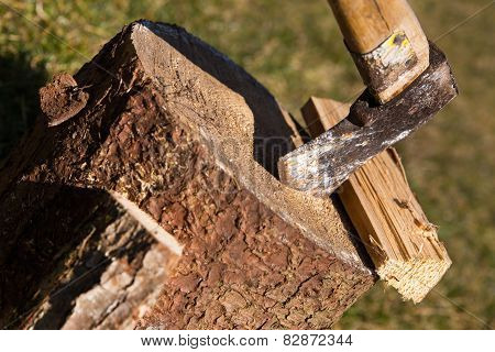 Wooden Block With Ax And Split Wood, Closeup