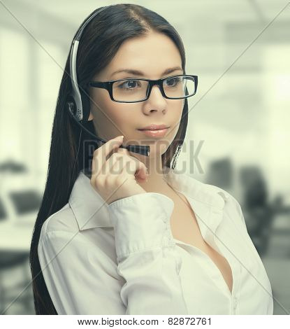 Young woman wearing a headset at work in the office