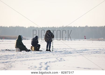 People Fishing On Ice