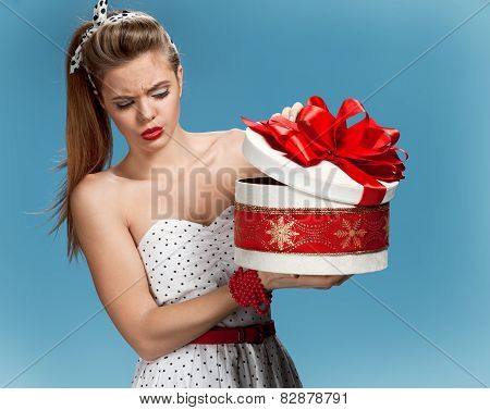 Suspicious girl opening gift box