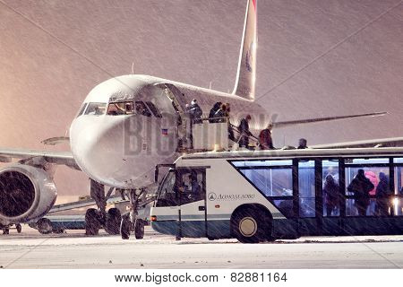 Moscow, Russia, February, 09,2015: out of the plane and the passengers sit in the bus
