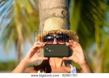 Woman On Caribbean Travel Taking Photo