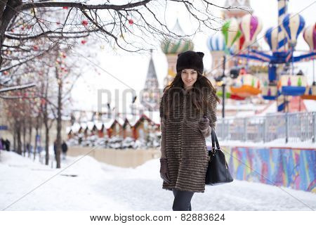 Portrait of a beautiful young woman in a mink hat on a red square, Moscow Russia (2015)