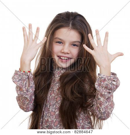 Beautiful little girl shows that she was nine years old, isolated on white background