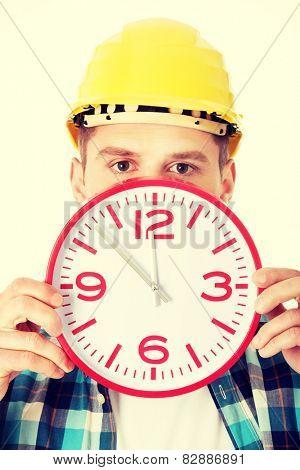 Businessman wearing helmet with clock .