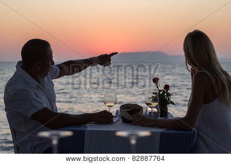 Couple in beach restaurant on sunset