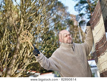 Man And Carpet Beater