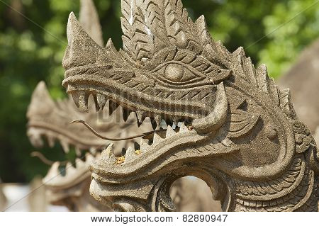 Exterior detail of the Naga (giant snake) protecting the Haw Phra Kaew temple in Vientiane Laos.