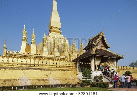 People visit Pha That Luang stupa in Vientiane, Laos.