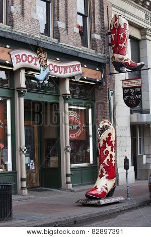 NASHVILLE, TENNESSEE-FEBRUARY 4, 2015:  Broadway Street in Nashville, Tennessee is the hub of the Honky Tonk district.  Cowboy boots are a featured item.