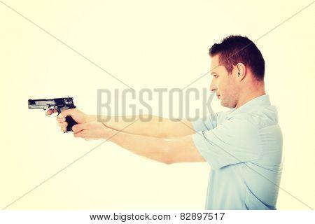 Man holding handgun and aiming
