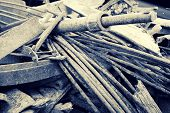 stock photo of scrap-iron  - A close up of a pile of old corroding scrap metal - JPG
