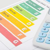 stock photo of fuel efficiency  - Colorful energy efficiency chart with calculator  - JPG