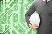 stock photo of shale  - Engineer with green digital circuit on background - JPG