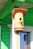 stock photo of farmhouse  - Wooden birdhouse on the terrace of the farmhouse - JPG
