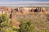 foto of semi-arid  - Sandstone formations along the canyon walls in Colorado National Monument with the Colorado River valley in the background - JPG
